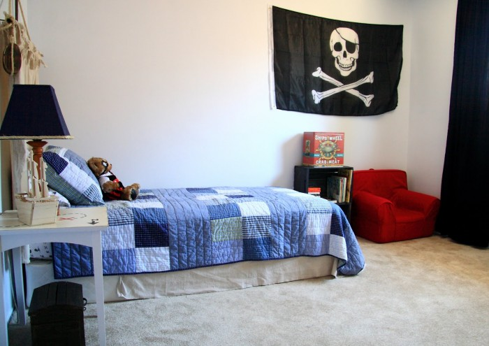 blue and red boys room with pirate accessories