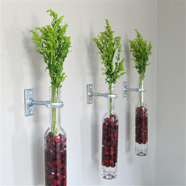 bottles wall mounted with floral berry and foliage display