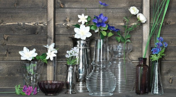 collection of vases with assortment of wild flowers