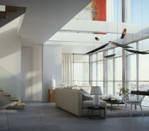 Soaring ceilings, glass walls and white and neutral walls and floors allow light and air to flow organically through the space.