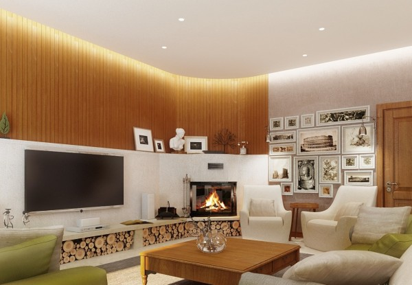 Wood paneled walls are lit around the top for a border-like effect. The wood accent is carried into the room by a coffee table in the same finish.