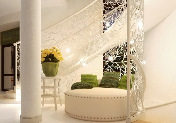 The lovely custom wrought iron stair rail offers a little niche perfect for a round settee.