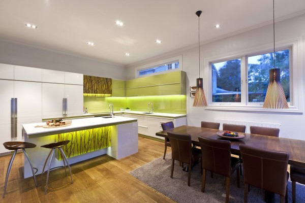 A touch of green, wood and faux bamboo gives this modern kitchen an organic feel.