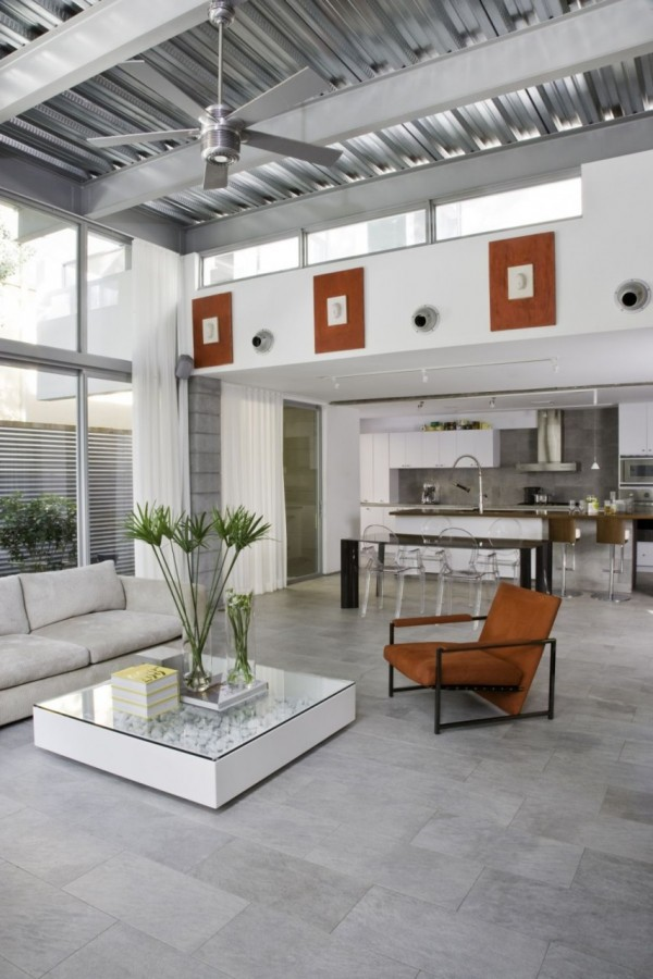 industrial open plan living with palm fronds