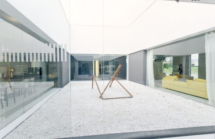 internal outdoor space with installation art and garden of white stones