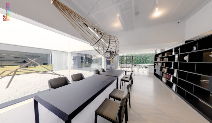 modern dining beneath installation with running bookcases