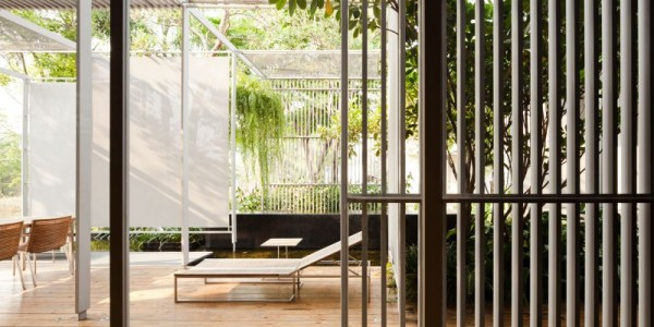 The main outdoor living space features a dining area, lounge area and conversation area set amongst natural and man made privacy barriers.