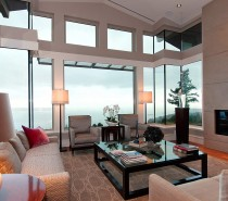 Large open spaces like this living room fill the 4400 sq ft penthouse. Furnishings are a mix of contemporary and modern furnishings.