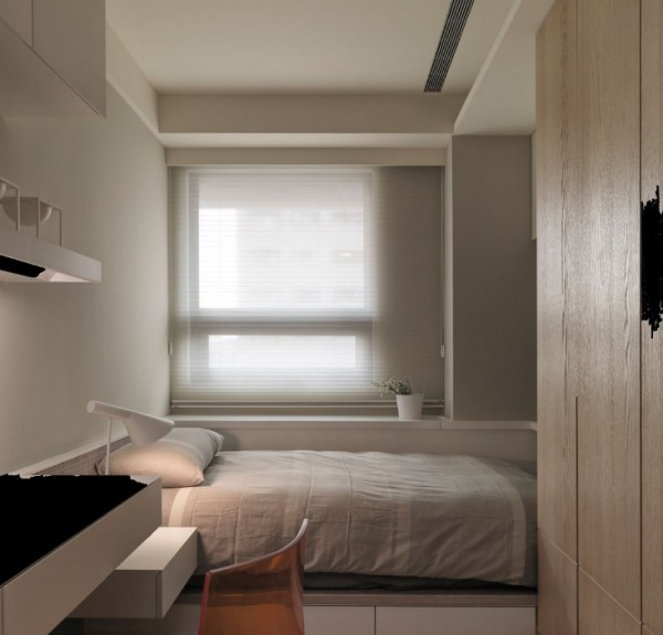 The second bedroom is decorated in soft greys and whites with dramatic touches of black.