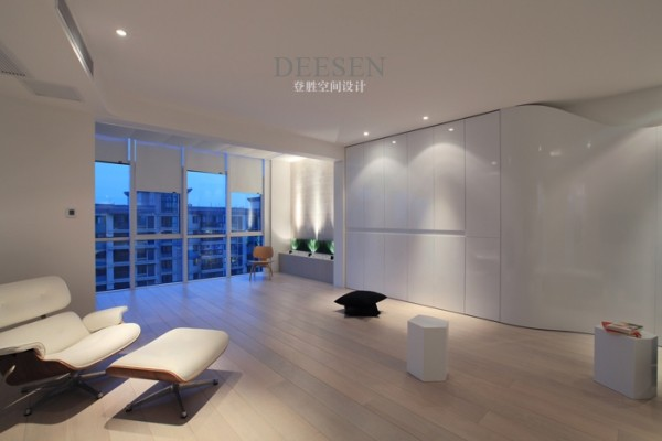 open plan down lit living with sleek statement furniture