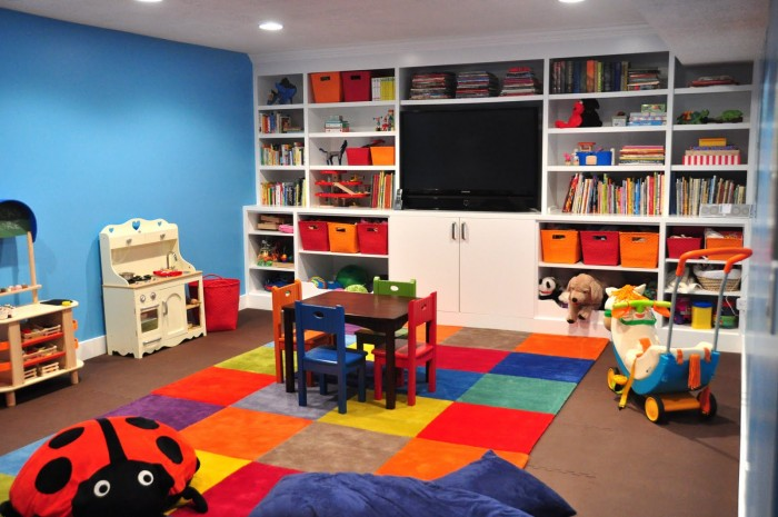 patchwork rug of bright multicolored squares built-in storage and flatscreen TV
