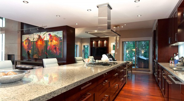 The penthouse's kitchen filled with gourmet appliances, custom wood cabinetry and eat-in dining.