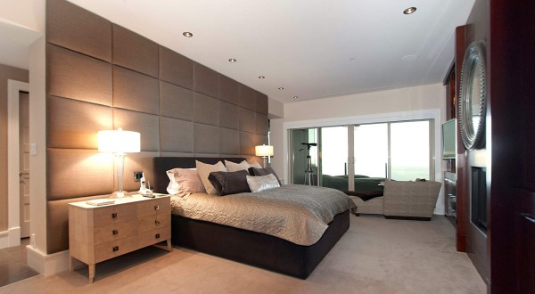 The master bedroom with luxury bathroom is open and light filled.