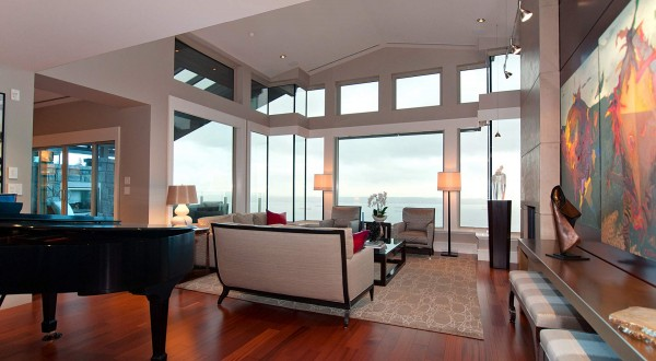 This view of the main open living space shows a massive wall of windows with panoramic views.