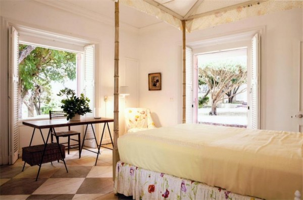 plantation shutters four poster sunny bright bedroom