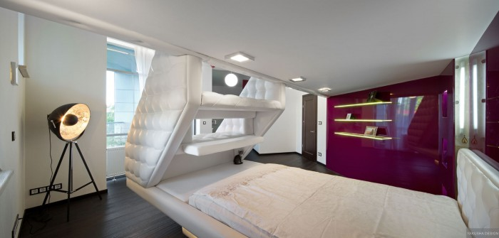 split level plush futuristic retro bedroom in white with red feature wall and tripod spot lamp