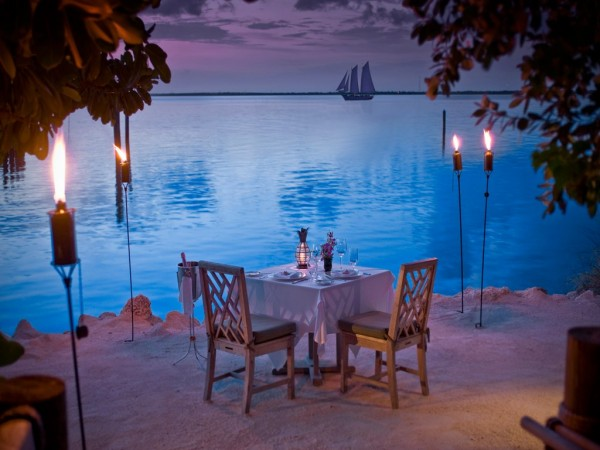torch lit beach dinner with ocean views
