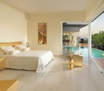 A retracting wall opens the master bedroom to the vast water views beyond and another of the villa's pools.