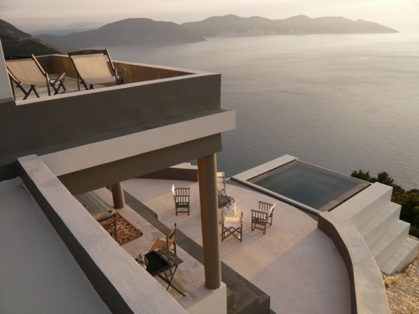 Once an abandoned house, Villa Delphina is now a luxurious vacation home set above the coastline of Mirtos Bay.