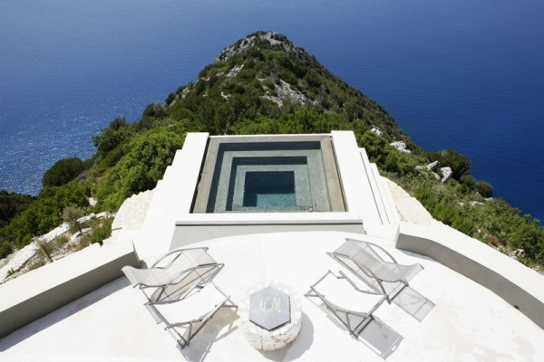 At the tip of the property is a small yet deep infinity pool poised over the cliffs beyond.