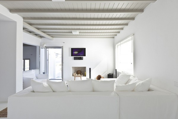 A minimalist white decor provides a relaxed serene ambiance. The small living room allows for intimate conversations or sitting quietly with a favorite book.