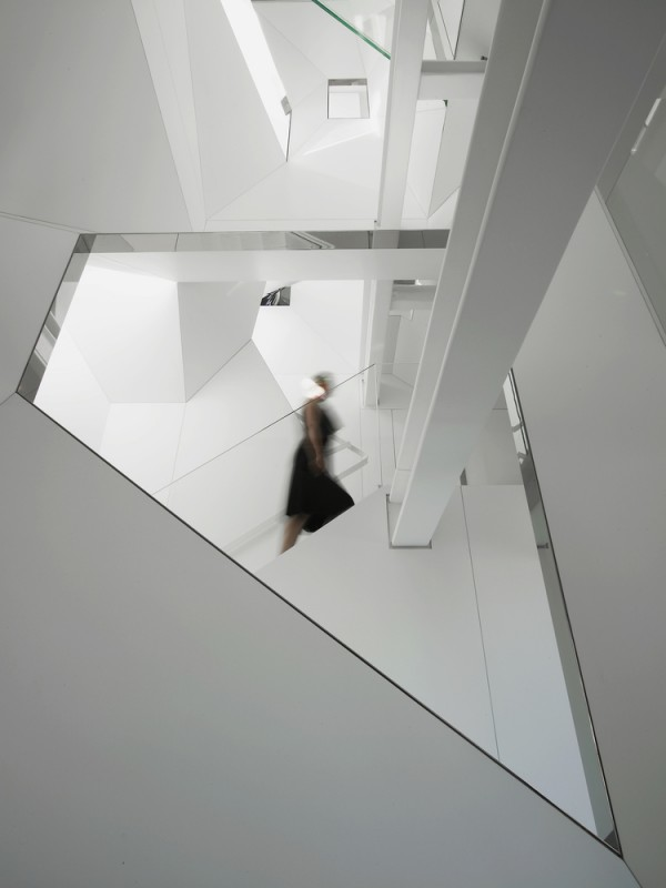 Angular internal stairwell in white with painted steel beams