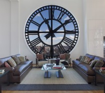 Clock Tower Apartment- White open plan living with clock face window leather and textural rug