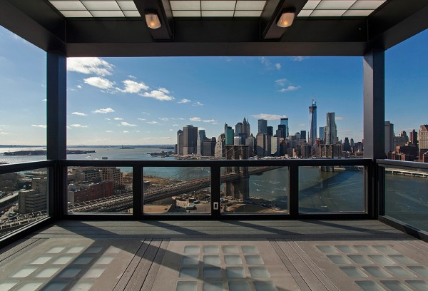 Clock Tower Apartment- covered rooftop with views of New York CIty