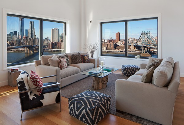 Clock Tower Apartment- neutral sitting area with views to New York City and statement soft furnishings