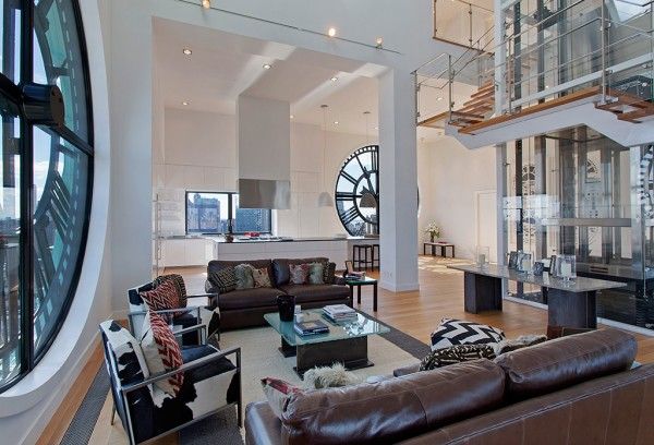 Clock Tower Apartment- open plan living in white with glass panelled staircase and elevator