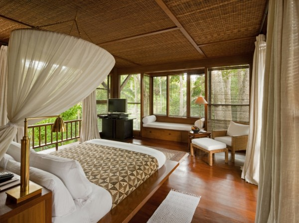 Como Shambhala Estate Bali- bamboo matting and wood organic interior of guest room