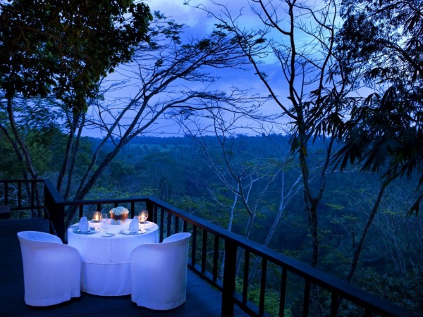Como Shambhala Estate Bali- dinner on the deck with views of evening forest