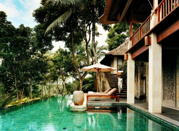 Como Shambhala Estate Bali- stone staircase access to infinity pool area with umbrella and deckchairs