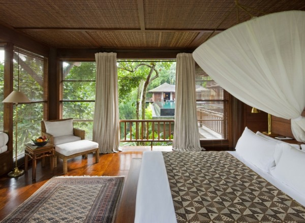 Como Shambhala Estate Bali- wooden and white guest room with balinese print textiles