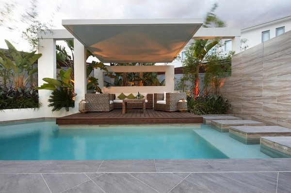 Custom Pool Area- covered outdoor lounge patio uplit with pool stepping platforms