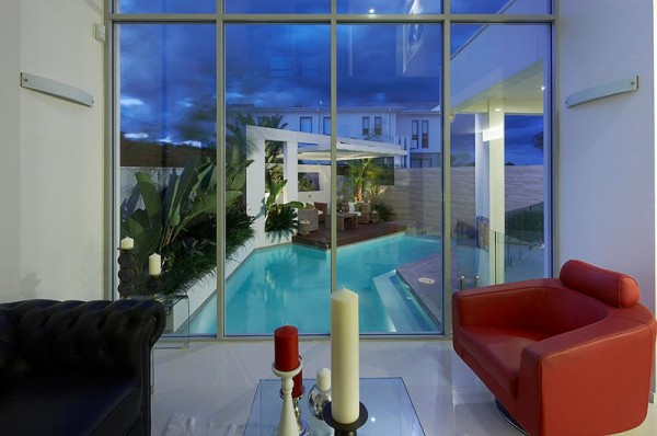 Custom Pool Area- red accented view from interior with glass panelled exterior wall