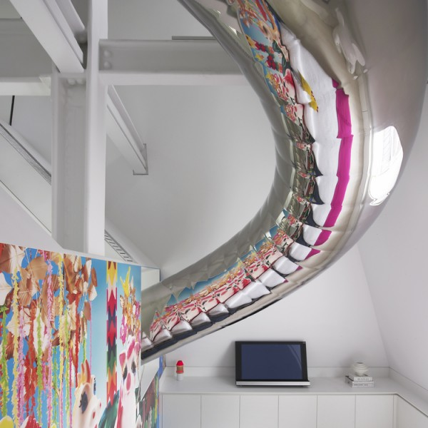 Metallic tubular slide passing through bedroom with reflection