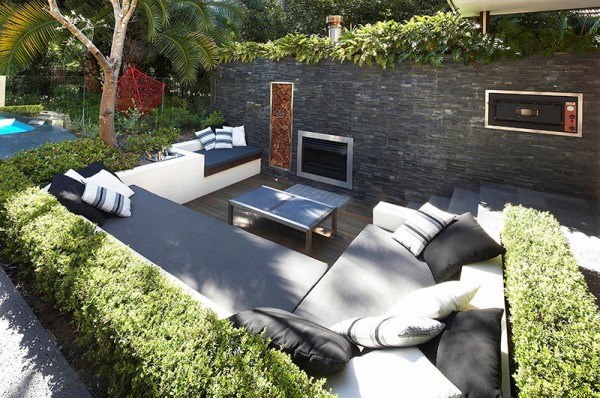 Outdoor Living with Sunken Lounge- hedges and stone wall with fireplace oven