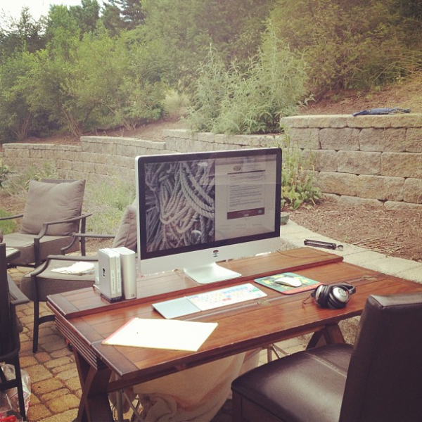 Workspaces such as this outdoor setup may not be expensive to create, but they do rely on the grace of the climate in which they exist. A similar energy can be realized by ensuring that the worker's line of sight when sitting is level with a conventionally positioned window and unobstructed by elaborate window treatments and unnecessary decorative items. Functional pieces such as basic office supplies and equipment, one should endeavor to conceal or place at a level lower than that of the line of sight in the interest of maximizing the view and minimizing distractions.
