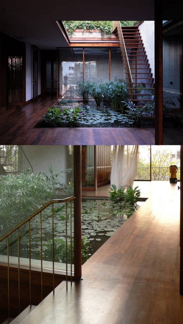 openair internal water garden surrounded by smooth wood