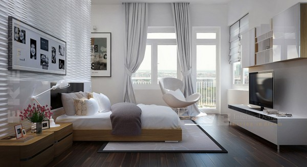 Tuananh Eke's modern white bedroom with heavy silver window treatments and entertainment unit storage