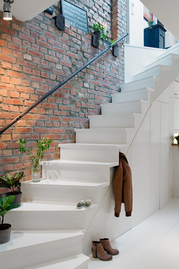 g Urban Apartment with Terrrace- white stairwell against exposed brick wall and natural styling
