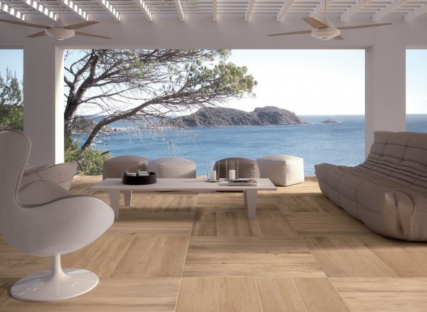 light outdoor space in white with wooden floor tiles and views