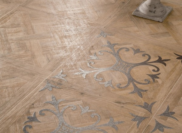 medium Patterned wooden floor tiles with fleur de lis motif closeup