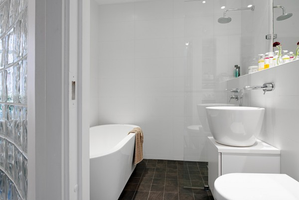 q Urban Apartment with Terrrace- monochrome bathroom with glass bricks and solid tub