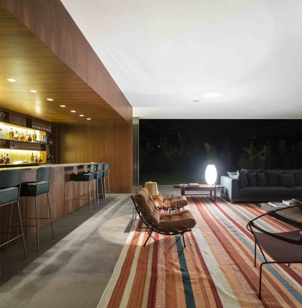 Marcio Kogan's Casa Lee Concrete House- bar living wood clad and down lit outdoor