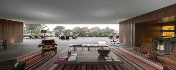 Marcio Kogan's Casa Lee Concrete House- open plan indoor outdoor living with pool view