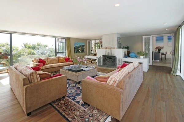 Sotheby's Auckland House- comfotable lounge with fireplace and views