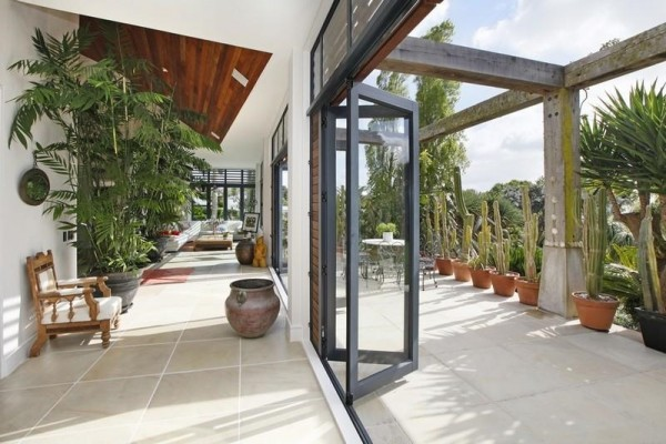 Sotheby's Auckland House- indoor outdoor living through glass acordian doors