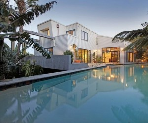 Sotheby's Auckland House- view of modern facade from pool house exterior